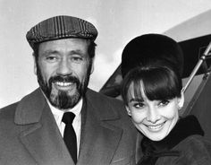 The actress Audrey Hepburn photographed with her husband Mel Ferrer (actor, dialogue coach and film director) during their arrival at the Heathrow Airport in London (England), from Zürich (Switzerland), on January 19, 1965.  Audrey was wearing:  • Hat:...