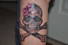 Girly skull crossbones with pink bow tattoo