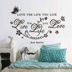Love the Life you Live, Live the Life you Love - Bob Marley Removable wall decal. Available in black or white. It is made of quality vinyl and will look fabulous any room of your home. The example shown measures 65x45cm, but the completed size will depend on your placement A clear plastic sheet of film (also known as the transfer sheet) is provided with the decal in order to transfer the design from the backing paper to the wall. It can also be used to store and re-apply your design s...