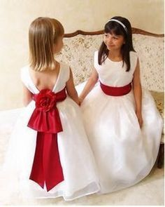 Red and white flower girl dresses - although make the ribbon to match the colour of the bridesmaid dresses