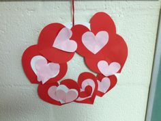 Heart Wreath, NEED: Construction paper, poster board (backing and cut in circle), string