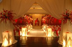 Love the light underneath these tables with the red arrangements on top. Beautiful! Great idea!