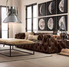 This tufted leather couch is effortlessly glamorous. This is a trait I find intriguing.   (Restoration Hardware)