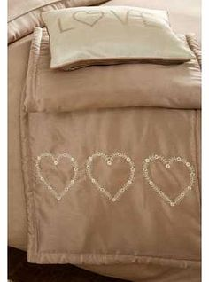 Catherine Lansfield Deco Hearts Gold Runner This gold runner has been specially designed as the perfect finishing touch to the Decorative Hearts bedroom range. Made from soft easy care fabric with embroidered heart details to drape over your be http://www.comparestoreprices.co.uk/bedding/catherine-lansfield-deco-hearts-gold-runner.asp