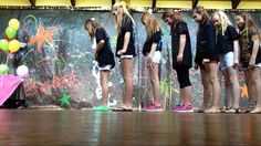 Best view of the backdrop we made. Used long sheets of black bulletin board paper and used washable neon tempera paints. Added foamy sticky stars. Held up (it was about 15 feet high) with some great party tape from School Aids. In this pic, some of the girls are working on a special dance! The neons showed well in black light...black light is a must!!! The bulbs are at every party store...probably Home Depot and Lowes too.