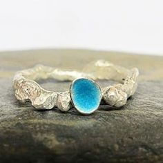 This is an organic style sterling silver ring with aqua blue enamel! #aqua #turquoise #turquoisering #rusticfashion #rusticring #blue #thesea #rocktexture #northlondon #muswellhill #crouchend #crouchendjeweler #nature