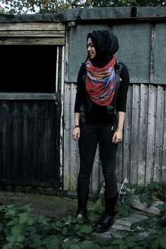 Imaan And Beauty Red Native American Print Hijab, Simply Hijabs Black Maxi Hijab, Primark Black Long Sleeve Top, Forever 21 Black Skinny Jeans, Skagen Watch, Dr. Martens, Little Aila Four Finger Knuckle Ring, New Look Sleeveless Faux Leather Biker Jacket