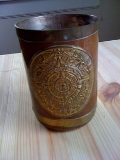 This vintage handled handmade Mid Century Mexican mug has a copper and brass veneer and details and features a Mayan or Aztec calendar. It stands 4 Aztec Calendar, Copper And Brass, Mead, Mug Cup, Random Stuff, Cups, Mid Century, Mexican, Glasses