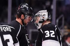 Los Angeles Kings center Anze Kopitar, left, of Slovenia, and goalie Jonathan Quick congratulate each other after the defeated the Tampa Bay Lightning in an NHL hockey game, Sunday, Dec. 6, 2015, in Los Angeles. The Kings won 3-1. (AP Photo/Mark J. Terrill)
