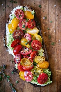 Loaded Avocado Toast Recipe Topped with Tomatoes, Thyme, and Ricotta #vegan #vegetarian #vegetarianrecipes #avocado #healthy #healthyrecipes #healthyfood