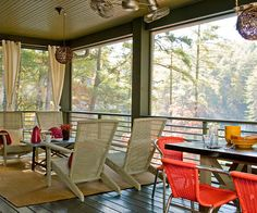 Screen porch:  outdoor living space among the trees.  Love the multiple conversation areas and calming colors.