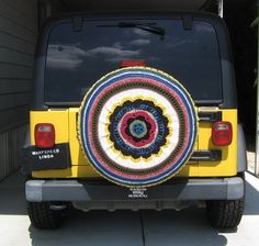 Too cute!!!  But, driving through muddy rain storms might be sad!! Crocheted Car Tire Cozy