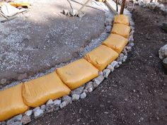 Earthbag foundation made with gravel-filled bags on a rubble trench.
