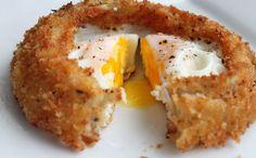 Fried Eggs Inside an Onion Ring via Brit + Co.