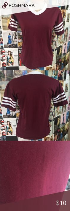 Maroon short sleeve V neck.! V neck shirt with Short sleeves, with three stripes on the sleeves.! augusta Tops Tees - Short Sleeve