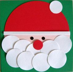 All you need is lots and lots of circles to make your own Santa :)