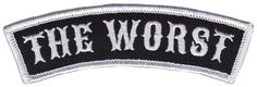 "DUMB JUNK THE WORST PATCH - You're The Worst, just embrace it. This classic black and white embroidered patch from Nik Scarlett measures 4"" wide x 1.25"" high and has an iron-on backing."