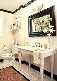 Love this trim ... great black and white bathroom