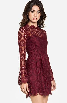 Lace fit and flare dress featuring lining from bust to hem, long bell sleeves, and an invisible back zipper with hook and eye closure. By DV Dolce Vita.