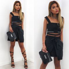Carmen wears the D-Ring Crop Top and Wrap Skirt