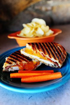 Chicken Bacon Ranch panini     8 slices Crusty French Bread     4 Tablespoons Softened Butter     2 whole Chicken Breasts, Cut In Half From Top To Bottom     Spicy Mustard     Ranch Dressing (homemade Or Bottled)     4 slices (thick) Sharp Cheddar Cheese     8 slices Bacon, Cooked Until Chewy And Cut In Half