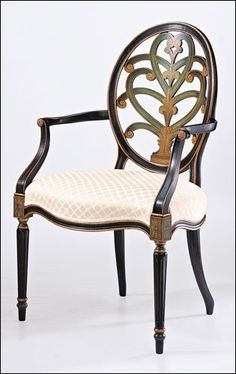 Hand-painted English style beechwood armchair with carved oval backsplat, antiqued black and green finish on the front and back, antiqued goldleaf accents and ivory upholstery