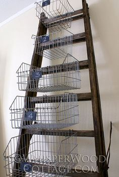 Old ladder, wire baskets, and chalkboard labels.  love.