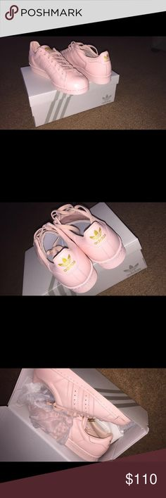 Customized Adidas Sneakers Super cute baby pink adidas with gold branding. I ordered the wrong size therefore I've never worn them but couldn't return them because they're customized. Adidas Shoes Sneakers