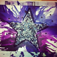 Crayon art. I made this piece using 2 techniques. One was the traditional hair dryer to melt the crayons around the edge of star and then I used a hot glue gun to melt the crayons to create the splatter effect on the inside of the star! I think it turned out amazing!
