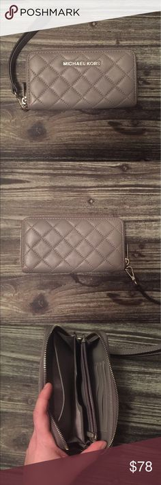"""Michael Kors Quilted Leather Wallet Authentic Michael Kors gray quilted leather """"Susannah"""" wallet in great condition! The inside is in perfect condition. Slight discoloration on stitching and zipper shown in last pic. This is a very cute wallet that can be used as a wristlet as well! MICHAEL Michael Kors Bags Wallets"""