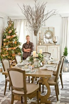 Traditional Elegance - Christmas in the Dining Room - Southernliving. Create a Christmas wonderland with elegant white china, napkins, and a centerpiece of greenery and white roses flanked by glowing white pillar candles. As for the tree, take your cues from the tablescape, and channel understated elegance by weaving a bronze ribbon through the branches. This elevated style is classic and always a Christmas crowd pleaser.