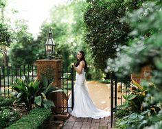 Ban at the entrance to the lower garden during her Bridal Session at the Duke Mansion in Charlotte, NC.