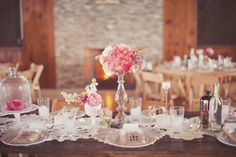 Pink Shabby Chic Country Wedding Tablescape - flowers on candle sticks on some tables and lanterns on the others