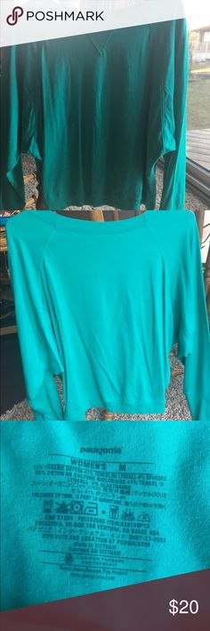Patagonia Teal Tee Teal colored long sleeved Patagonia tee. Women's medium. Fits tight at wrists and waist - looser fit around shoulders. Hardly worn. Patagonia Tops Tees - Long Sleeve