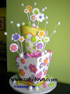 Colorful cake by Cake Lava Love the off center and uneven tops to