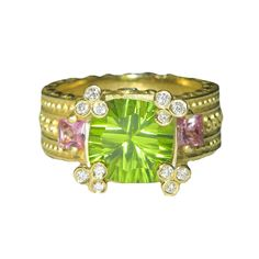 Stambolian Peridot Pink Sapphire gold Ring | From a unique collection of vintage three-stone rings at https://www.1stdibs.com/jewelry/rings/three-stone-rings/