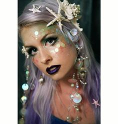 "Mermaid Makeup with shells and lavender hair from ""22 Spooky Halloween Makeup Ideas"""