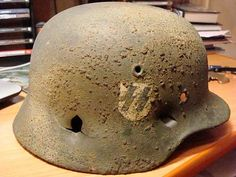 Another SS helmet with battledamage: hit with bullet in front. Check out my…