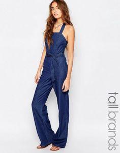 8f084cc5c59a Shop Vero Moda Tall Halterneck Denim Jumpsuit at ASOS.
