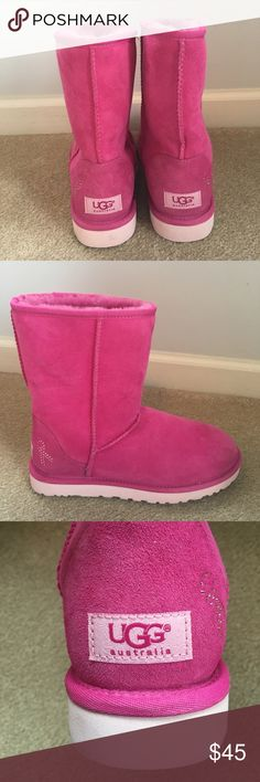 Hot Pink Uggs A hot pink version of the classic short Ugg. Breast cancer ribbon bejeweled decoration on the outer heel of each boot. Never worn. They have all the original product stickers but no box. UGG Shoes Winter & Rain Boots