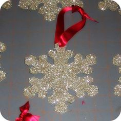 More homemade ornaments - cut snowflakes out of sturdy cardboard, cover with glue, and dust with glitter.