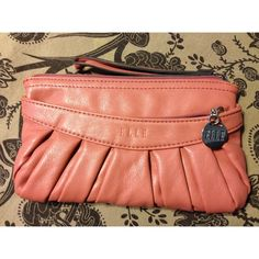 Elle Salmon Clutch In good condition except for small scrapes on the inside (as pictured). Otherwise in great condition on the outside! Elle Bags Clutches & Wristlets