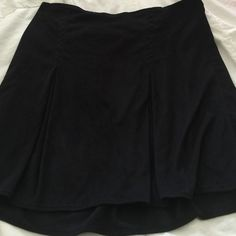 Brandy Melville black skirt! New! Never worn! Super cute Brandy Melville black skirt. Elastic on back. Has faux slits. Amazing new condition. Never worn. Brandy Melville Skirts Mini