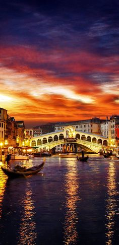 Ponte Rialto and gondola at sunset in Venice, Italy.