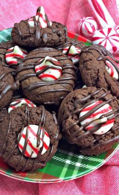These Chocolate Peppermint Thumbprint Cookies combine the two favorite flavors of the holiday season! A festive update on the classic Hershey Kiss cookie!