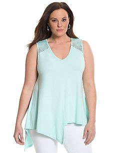 6th & Lane laser cut tank takes your look in a trend-setting direction with its alluring asymmetric silhouette. Soft knit tank layers beautifully and dresses up or down for fashionable versatility. V-neck. lanebryant.com
