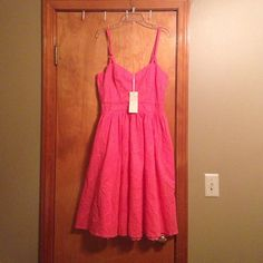 Brand new with tags coral sun dress Gorgeous coral pink sun dress with adjustable spaghetti straps and POCKETS!  Inner skirt has lace trim to add an extra special flare to the dress. Too big for me otherwise I'd keep it...my lose your gain! Aryeh Dresses