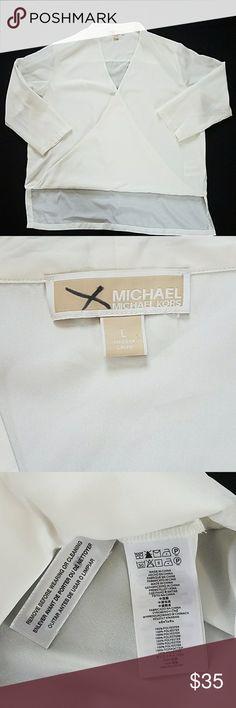 "Michael Kors Women's Large Ivory Faux Wrap Shirt Michael Kors Women's Large Ivory Faux Wrap Shirt.  Chest 23"" Waist 23"" Sleeve length 19"" Shoulder to bottom hem 22""  Smoke and pet free home. MICHAEL Michael Kors Tops Blouses"