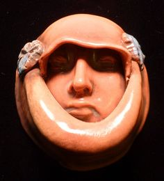 This face is now available on Etsy. Handmade ceramic face lady in waiting hand maid priestess