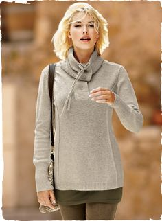 Sporty details—dimensional exposed seams, a convertible ribbed t-neck with ties and a henley placket—give this tunic its casual elegance. Knit of cloud-soft, woolen-spun royal alpaca, with antiqued brass buttons and ribbed trim.